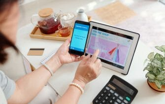 Woman shopping online and paying for purchases with banking application on smartphone